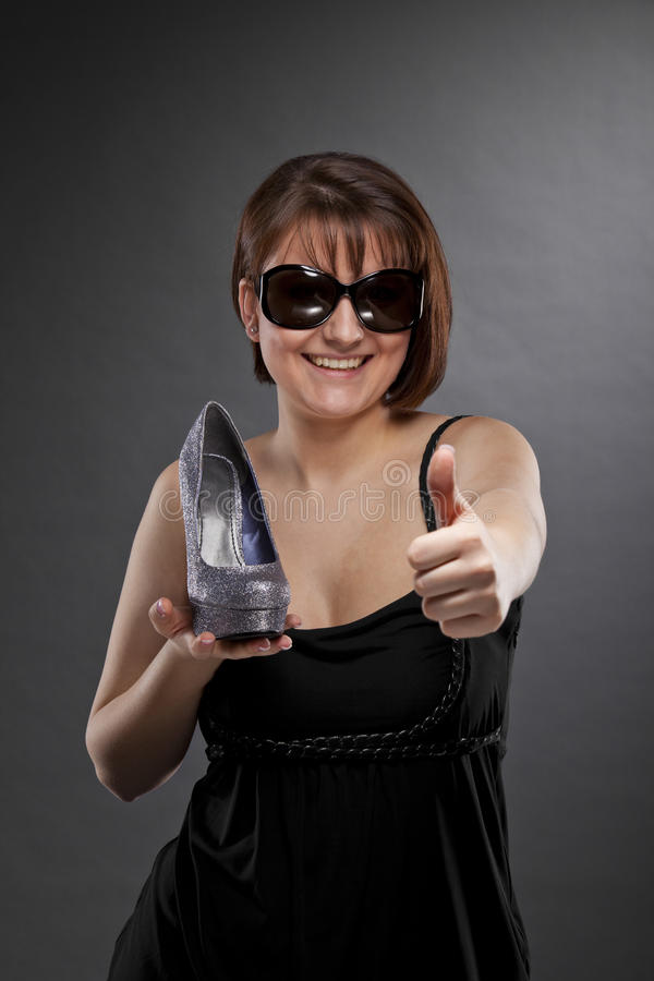 Smiling Woman With Shoe Posing Thumbs Up Royalty Free Stock Photography