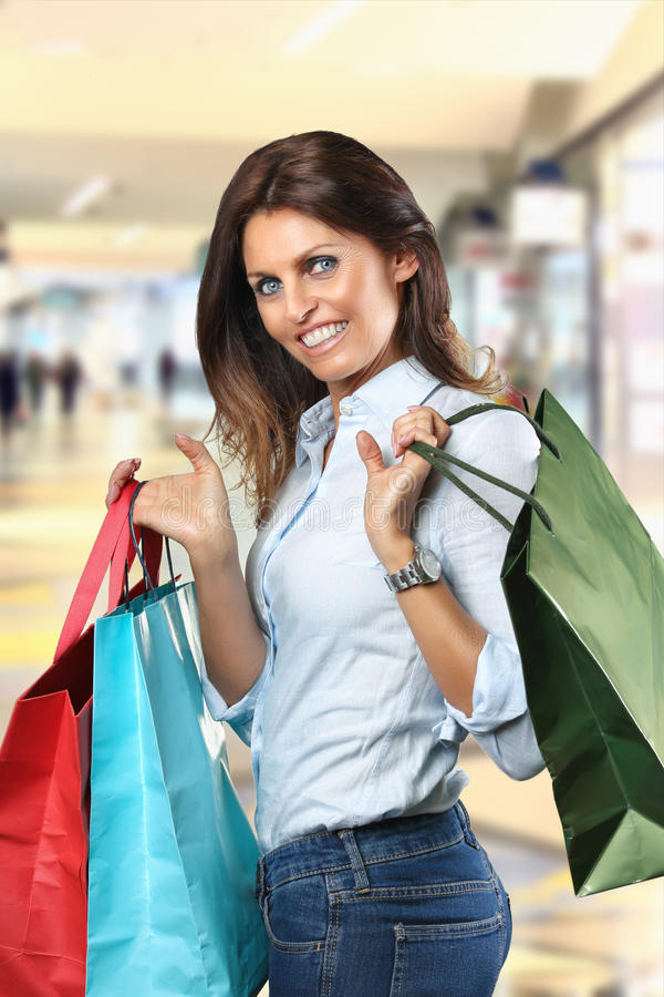 Smiling woman with shopping bags royalty free stock photo