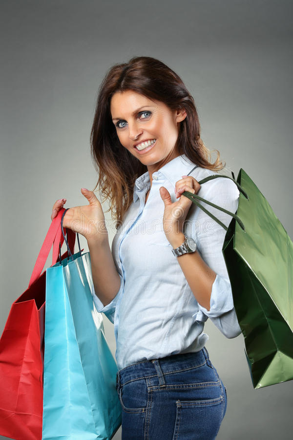 Smiling woman with shopping bags royalty free stock image