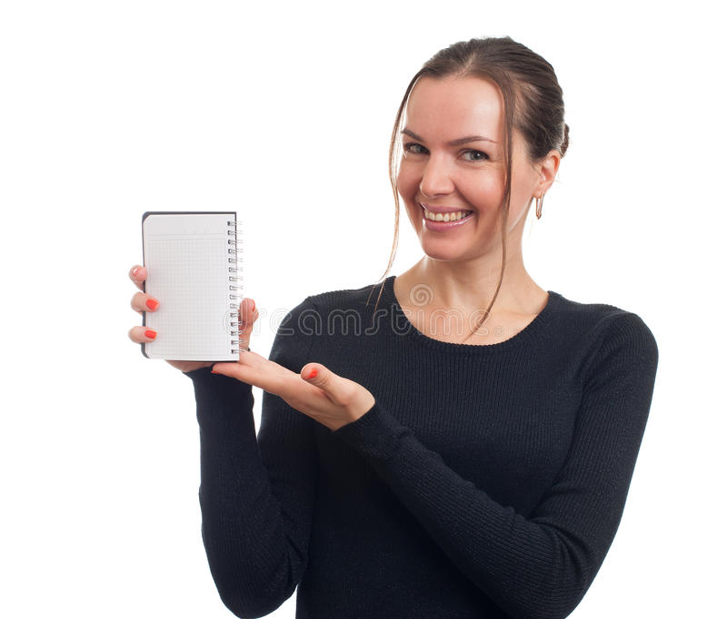 Smiling woman showing blank notepad royalty free stock photos