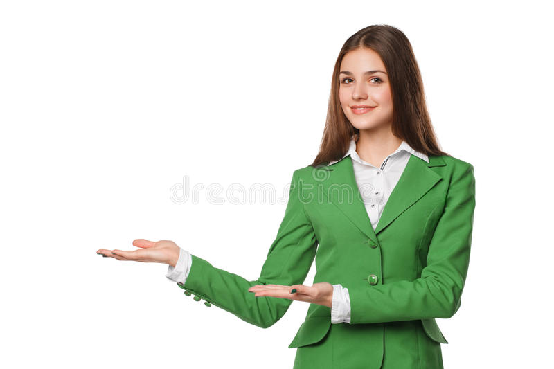 Smiling woman showing open hand palm with copy space for product or text. Business woman in green suit, isolated over white backgr. Ound royalty free stock images