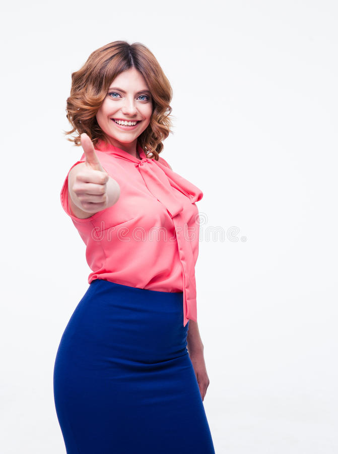 Smiling woman showing thumbs up royalty free stock image