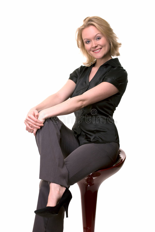 Smiling Woman Sitting On Stool Stock Photography