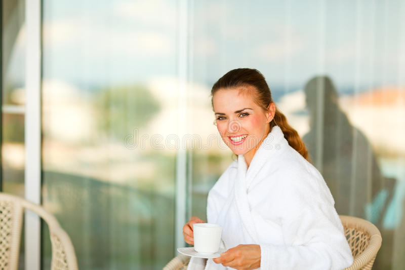 Smiling Woman Sitting On Terrace And Having Tea Royalty Free Stock Image