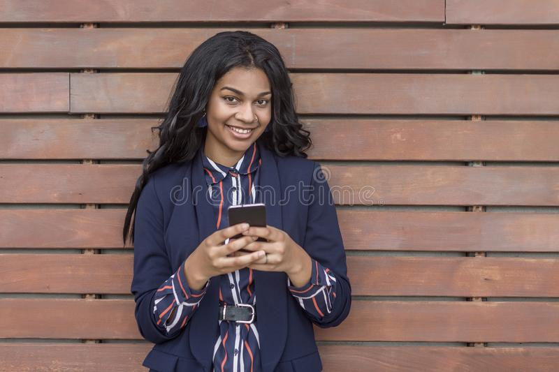 Smiling woman with smart phone stock photo