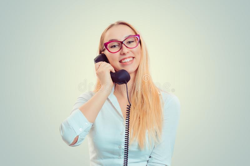 Smiling woman speaking on telephone stock image