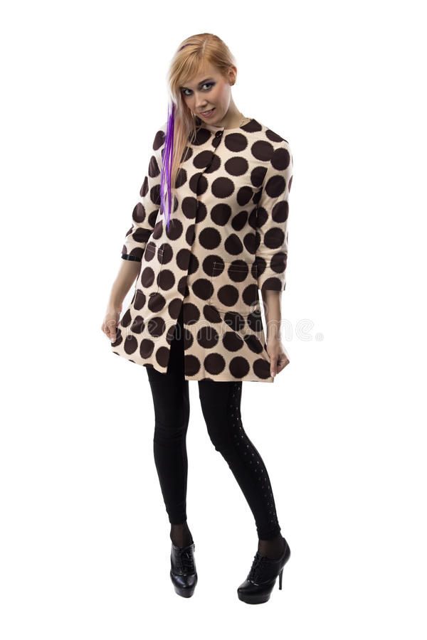 Smiling woman in spotted coat, chin down royalty free stock photos