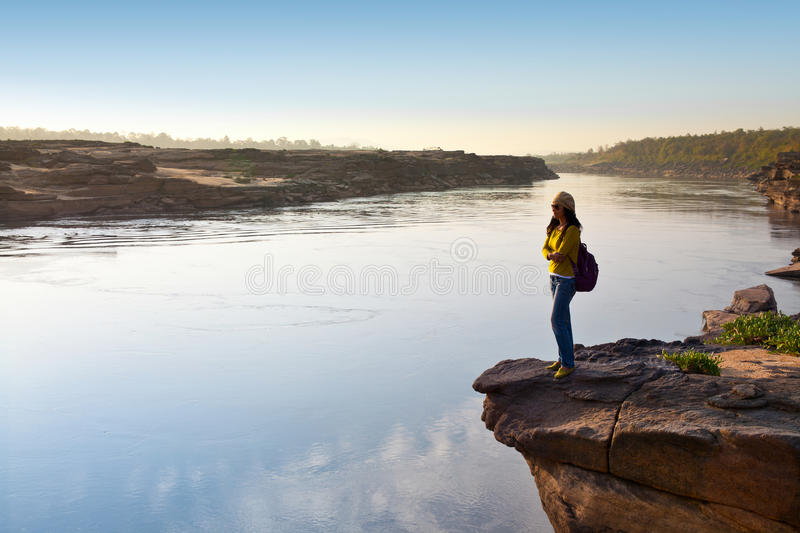 Smiling woman standing on a mountain royalty free stock photography