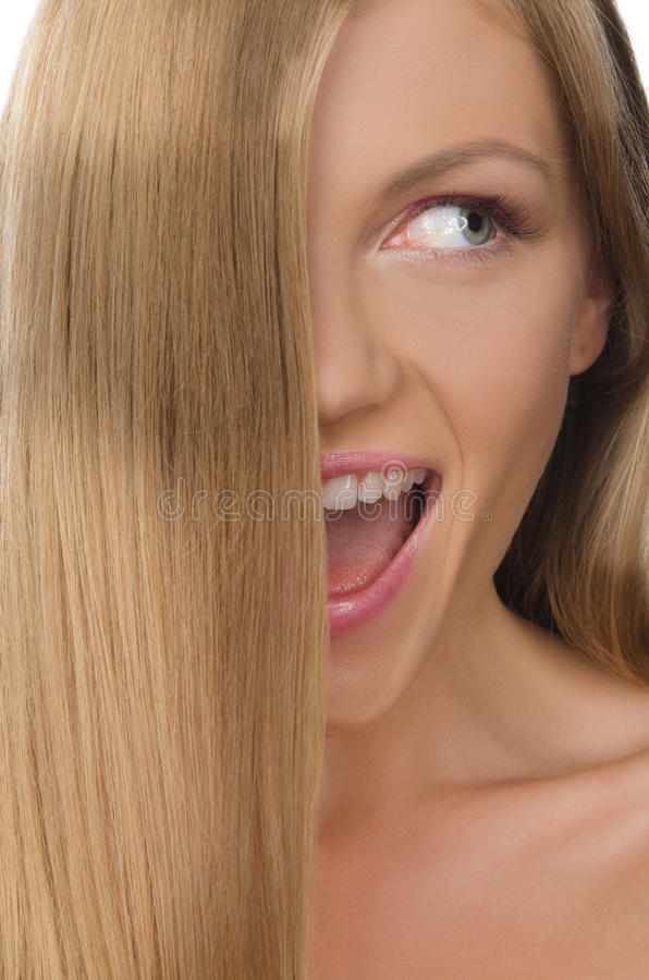 Smiling woman with straight hair looks away royalty free stock photo