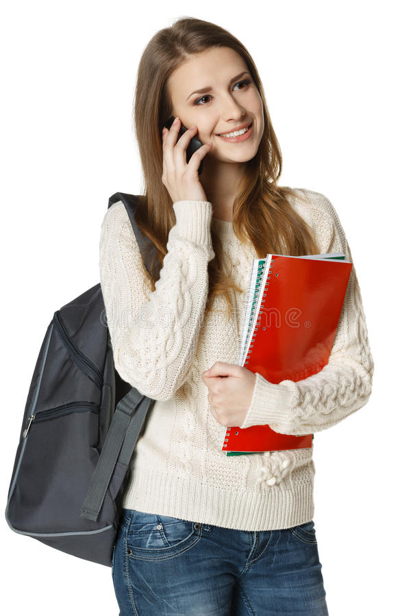 Smiling woman student talking on cell phone stock photography