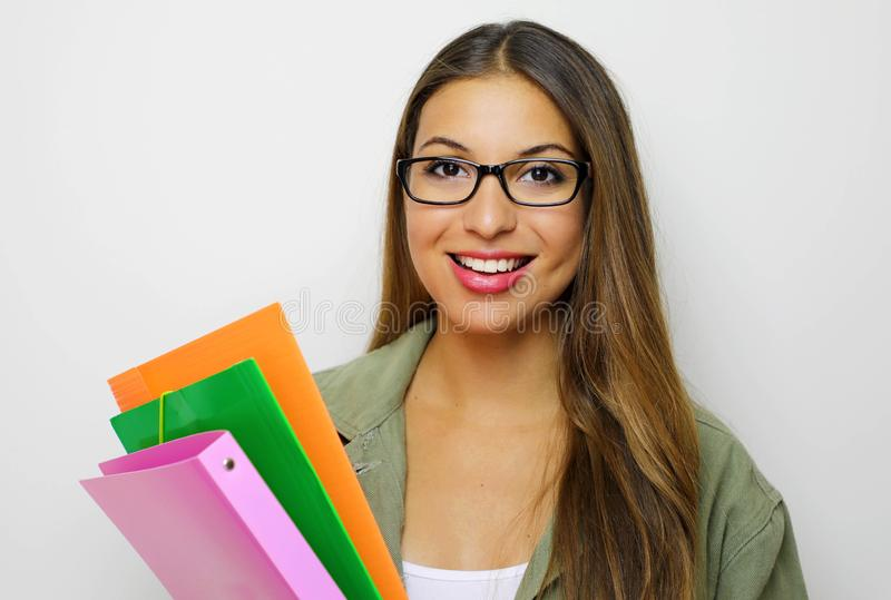 Smiling woman student, teacher or business lady holding folders. Isolated studio portrait of business person stock photo