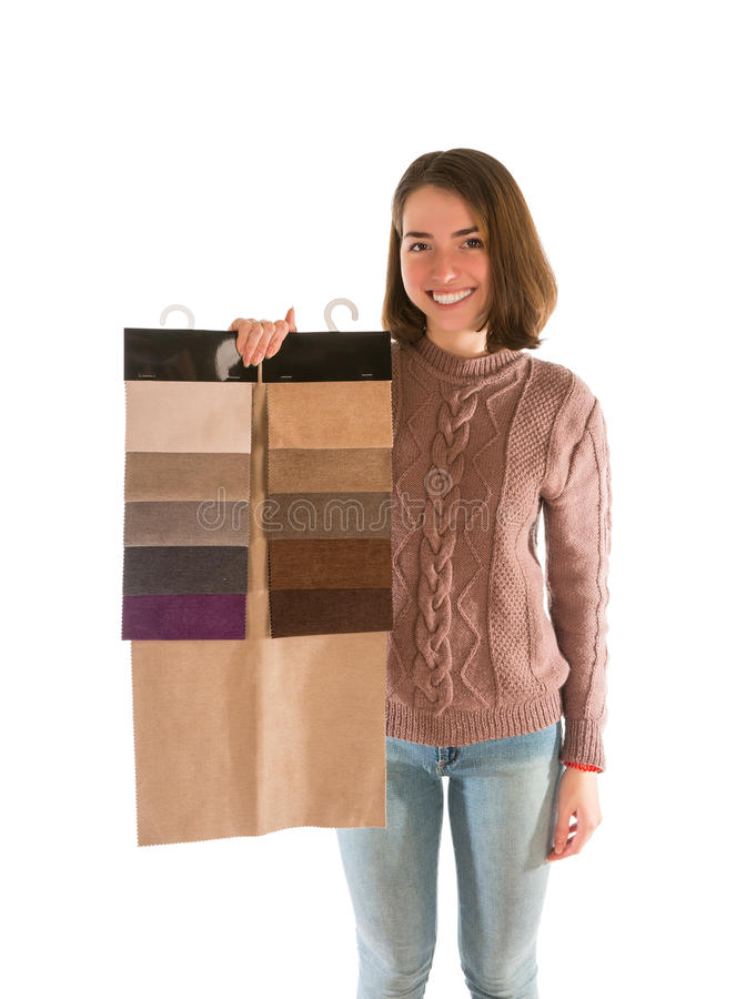 Smiling woman in sweater holding fabric swatches. Isolated on white background stock photos