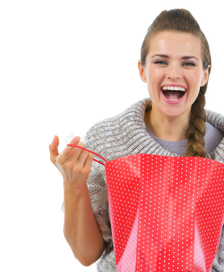 Download Smiling Woman In Sweater Opening Shopping Bag Stock Image - Image: 27680283