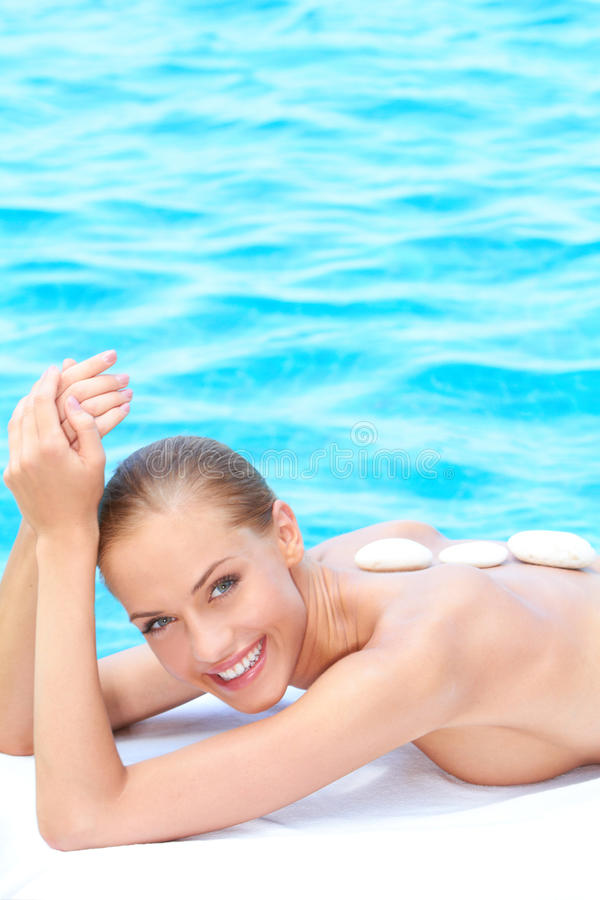 Download Smiling Woman Taking Spa Treatment Next To Pool Stock Photo - Image: 24283424