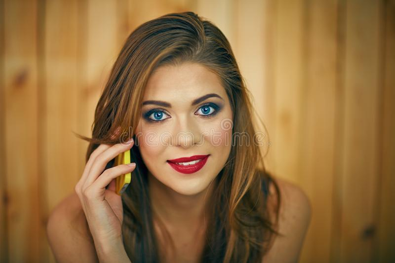 Smiling woman talkin phone. Beautiful girl face portrait royalty free stock photos
