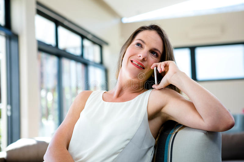 smiling woman talking on her mobile phone stock photos