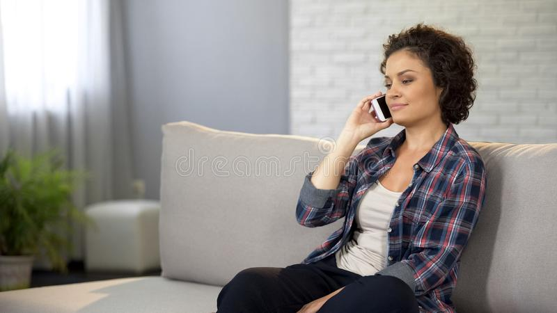 Smiling woman talking on phone, caring daughter calling parents, communication. Stock photo stock images