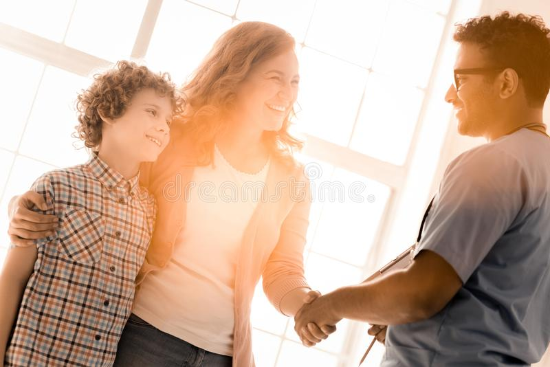 Smiling woman talking to family practitioner stock images