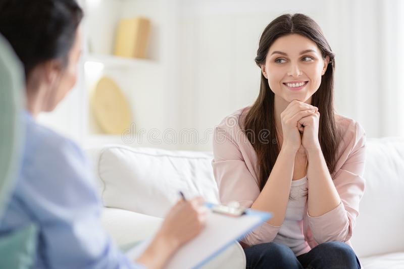 Smiling woman talking to wellness coach about motivation. Smiling women talking to wellness coach about motivation and happiness, free space royalty free stock images