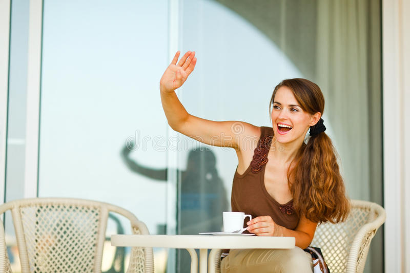 Smiling woman on terrace greeting someone stock photo image of download smiling woman on terrace greeting someone stock photo image of charming glad m4hsunfo