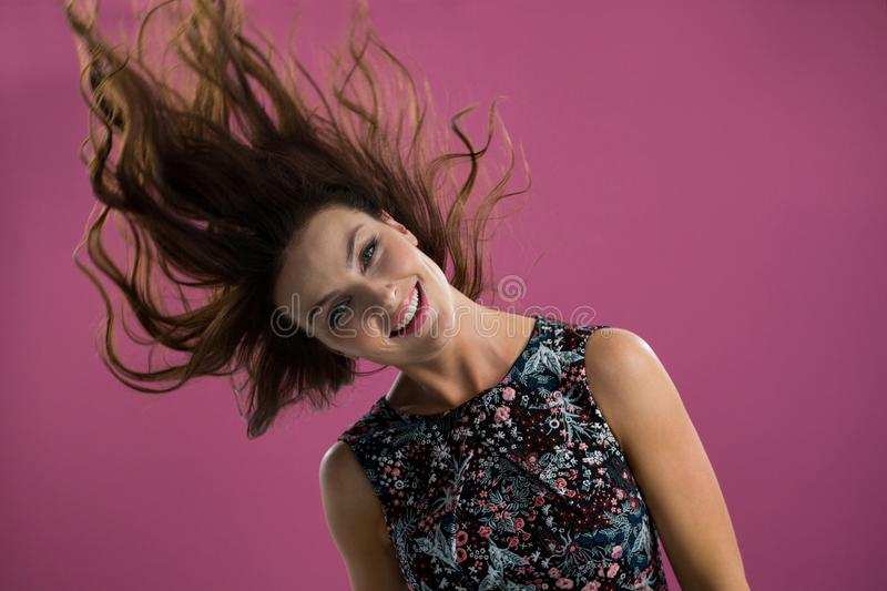 Smiling woman tossing her long hair stock photos