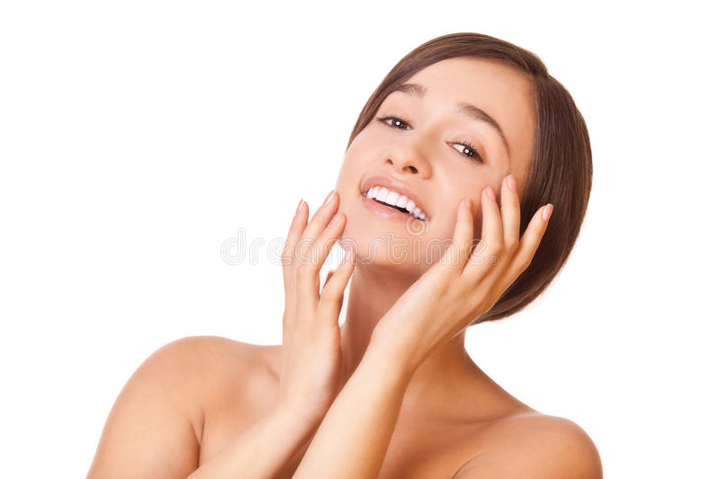 Smiling Woman Touching Face Royalty Free Stock Image