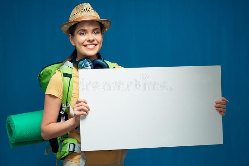 Smiling woman tourist holding white board with copy space stock images