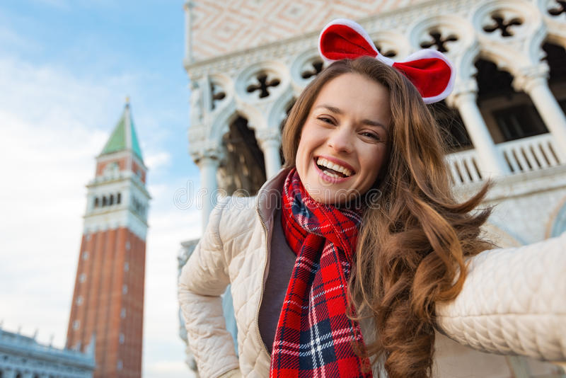 Smiling woman tourist taking Christmas selfie in Venice, Italy stock photo