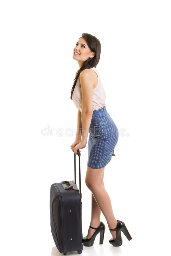 Smiling woman with travel luggage