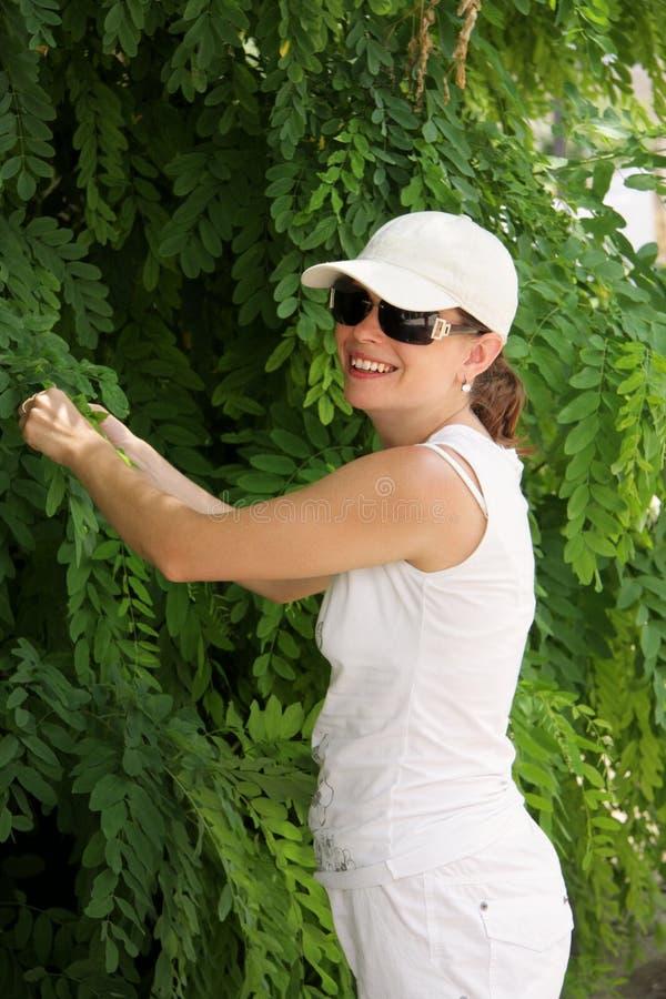 Smiling woman at tree stock photo