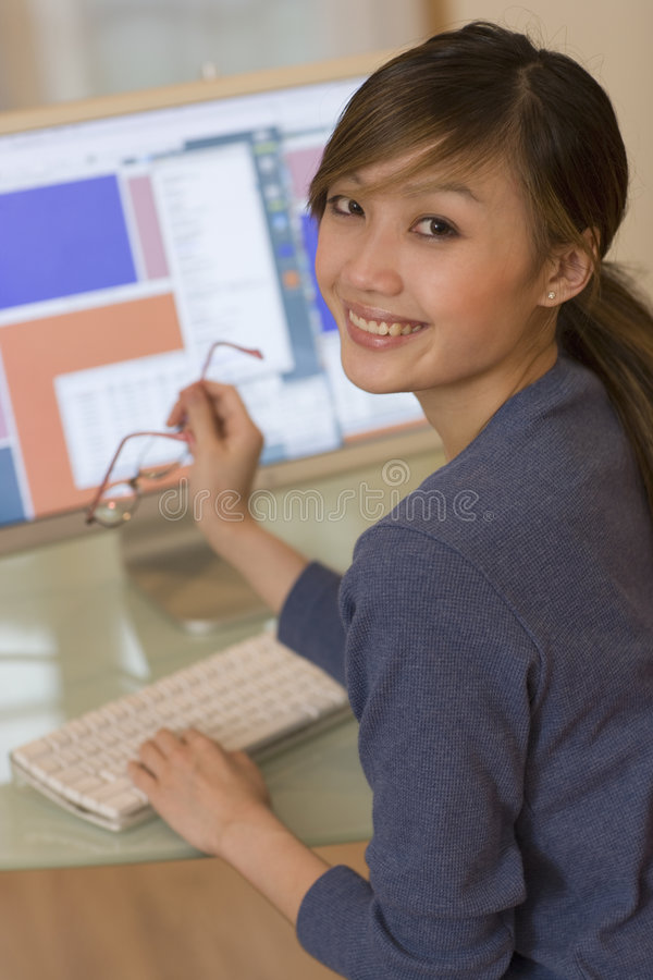 Download Smiling Woman Using Computer Stock Photo - Image of casual, internet: 5534396