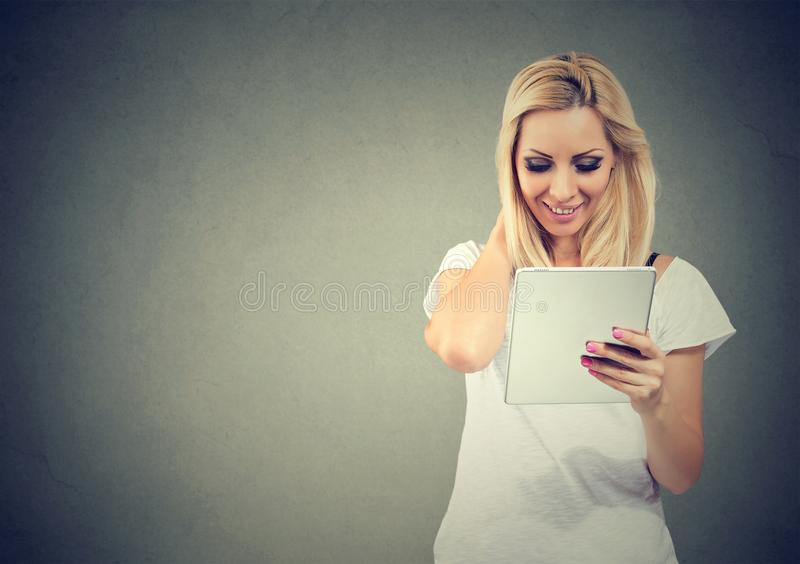 Smiling woman using modern tablet royalty free stock photo