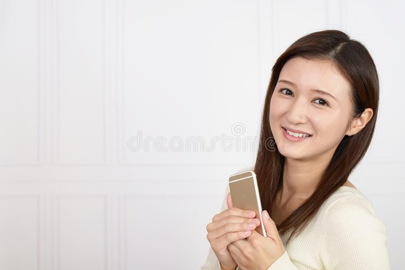Woman holding a smart phone royalty free stock photos