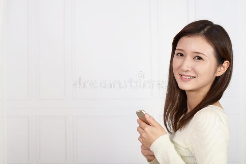 Woman holding a smart phone stock image