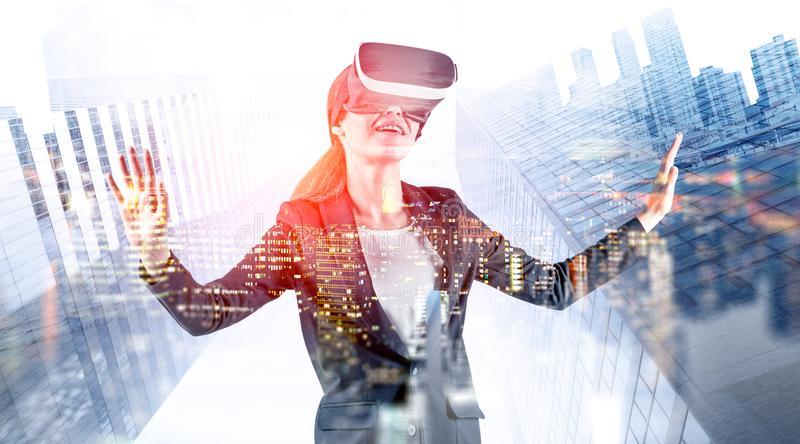 Smiling woman in VR headset in virtual city royalty free stock photography