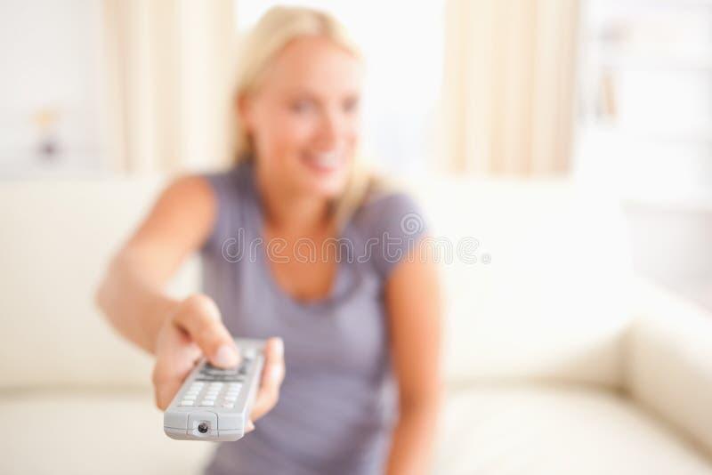 Download Smiling woman watching TV stock photo. Image of fashion - 20687212