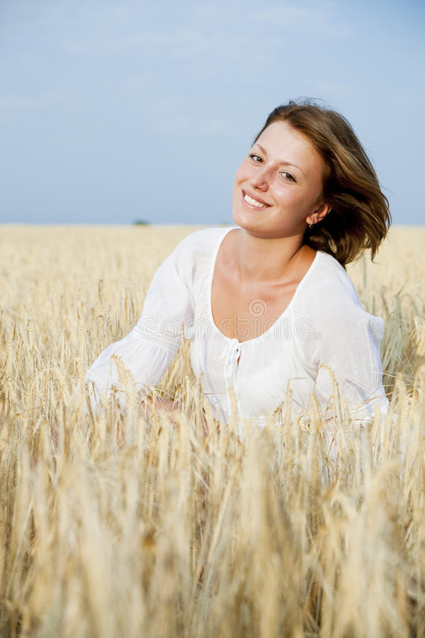 Smiling woman in wheat field stock image