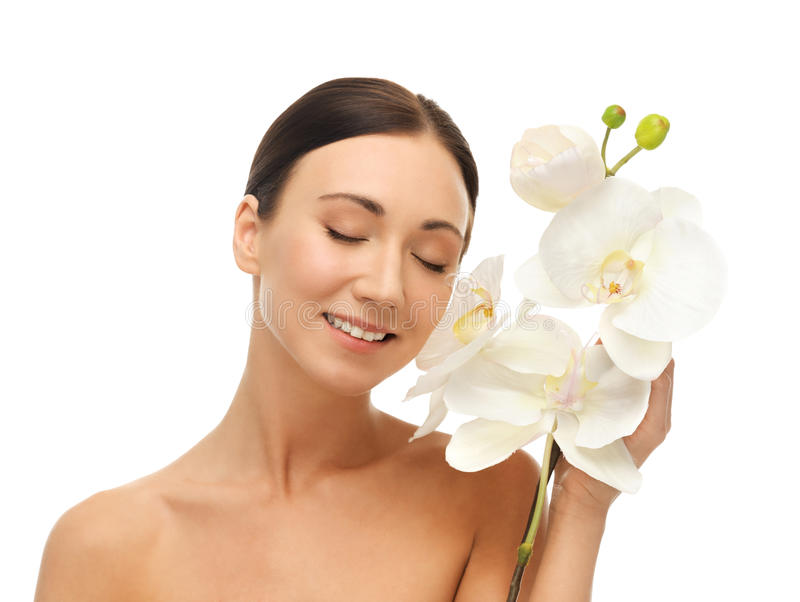 Smiling woman with white orchid flower stock images