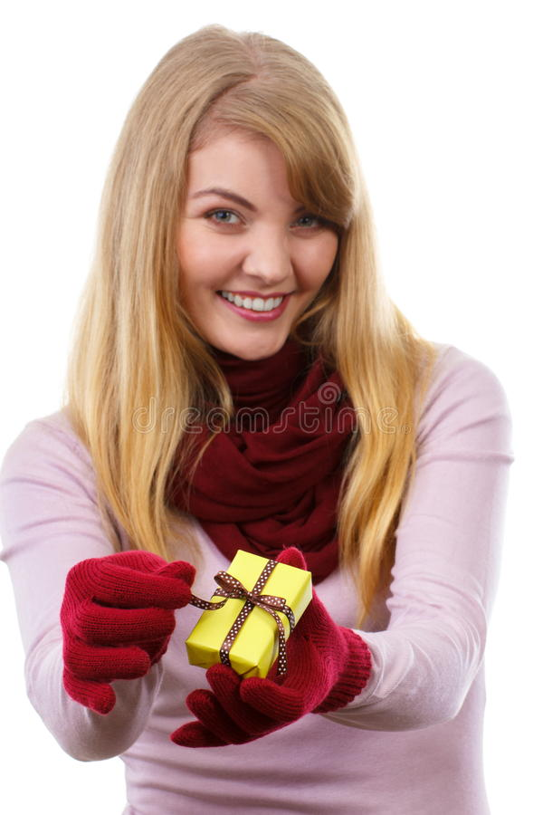 Smiling Woman In Woolen Gloves Opening Gift For Christmas ...