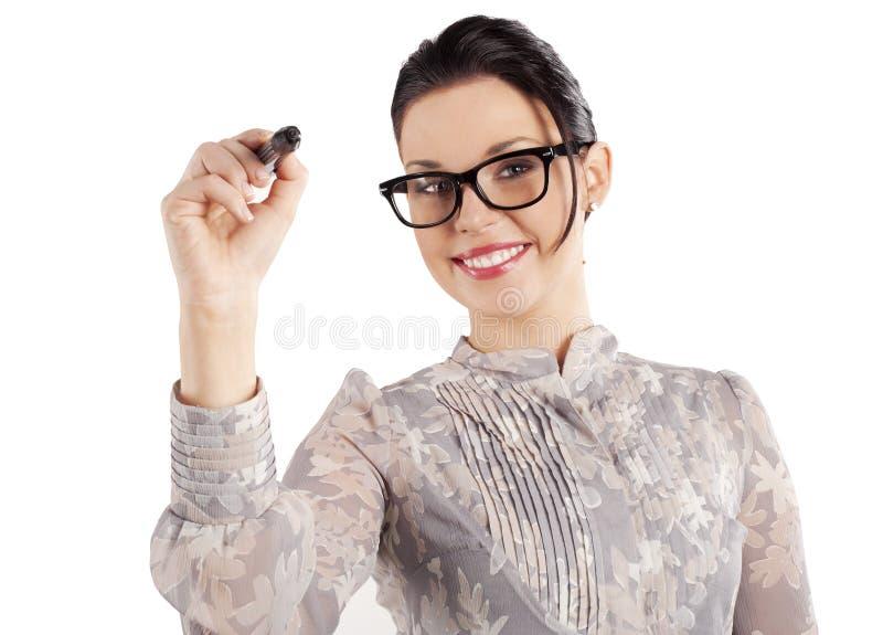 Smiling woman writing stock image