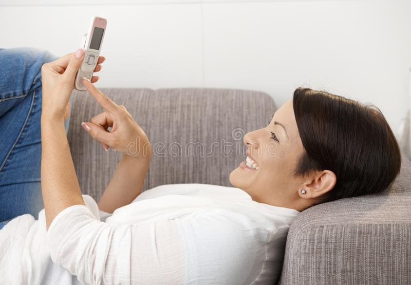 Smiling Woman Writing Text Message Royalty Free Stock Photos