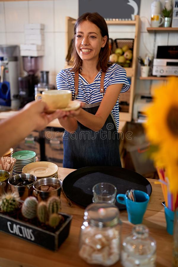 Woman barista at workplace at new open cafe store royalty free stock photography