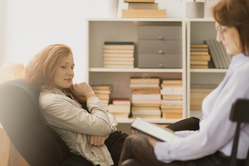 Woman during consultation with coach stock photo