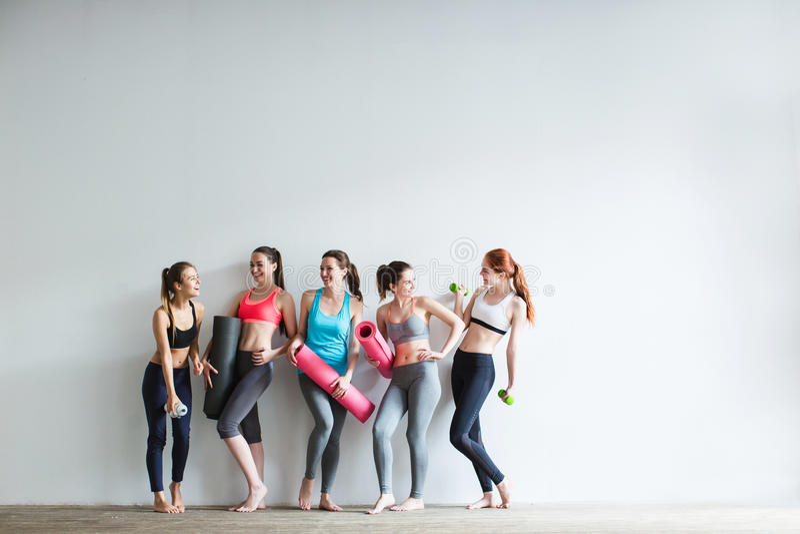 Smiling women in fitness studio. stock photography