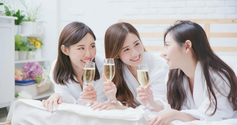 Asian women friend have champagne stock photo