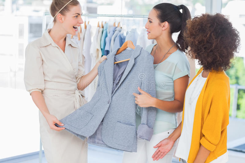 Download Smiling Women Holding A Blazer Royalty Free Stock Images - Image: 32510049