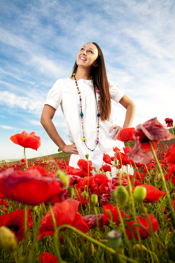 Smiling women in a poppy field royalty free stock photo