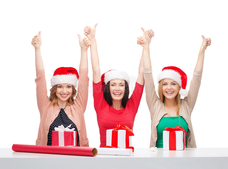 Download Smiling Women In Santa Helper Hats With Gift Boxes Stock Photo - Image: 34952858