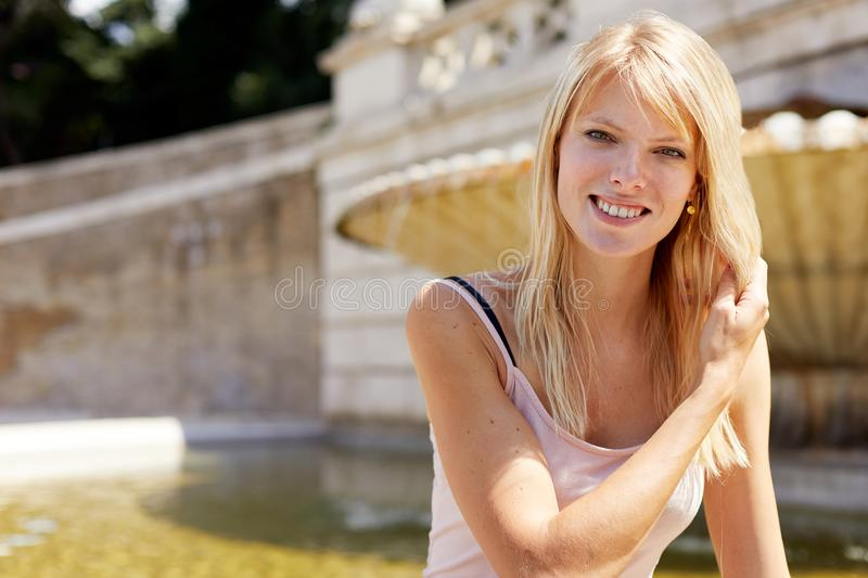 Smiling women seated outside in piazza del popolo royalty free stock photography