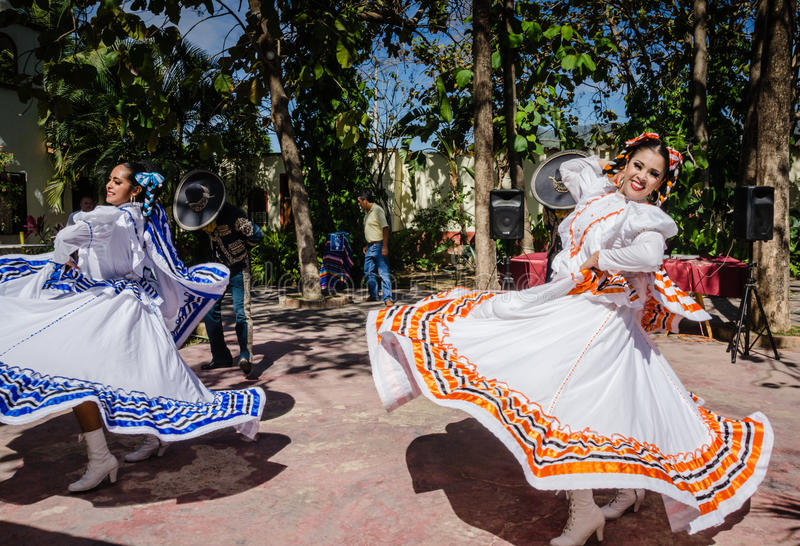 Smiling Women, Twirling Ribbon Skirts Flying - Puerto Vallarta, stock photography